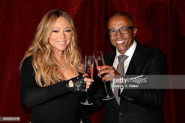 Singer Mariah Carey and Kevin Liles announce the launch of her Go N'Syde bottle 'Butterfly' at the Saint Regis Hotel on June 9 2014 in New York City