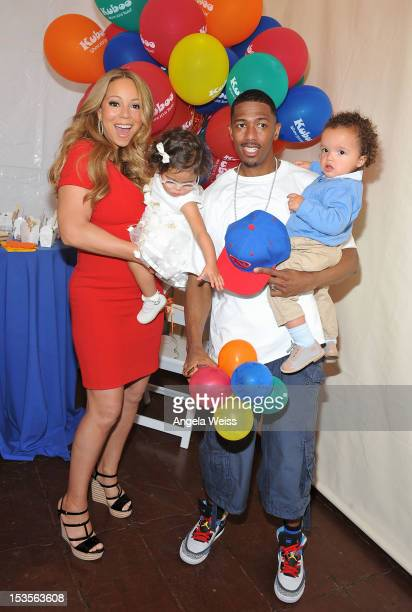 Singer Mariah Carey and TV personality Nick Cannon pose for pictures with their twins Monroe Cannon and Moroccan Scott Cannon during 'Family Day' at...
