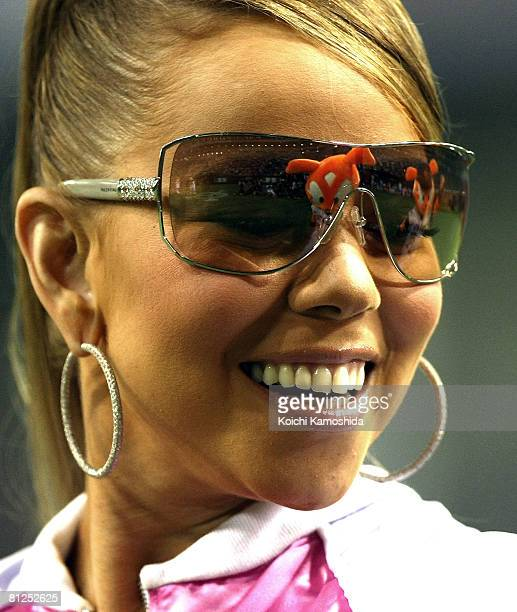 Singer Mariah Carey attends the ceremonial first pitch before Japanese professional baseball match between Yomiuri Giants and Rakuten Golden Eagles...