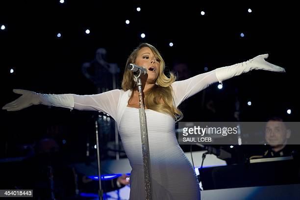 Singer Mariah Carey performs during the National Christmas Tree Lighting ceremony on the Ellipse adjacent to the White House in Washington DC...