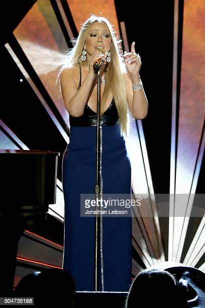 Singer Mariah Carey performs onstage during the Sixth Biennial UNICEF Ball Honoring David Beckham and C L Max Nikias presented by Louis Vuitton at...