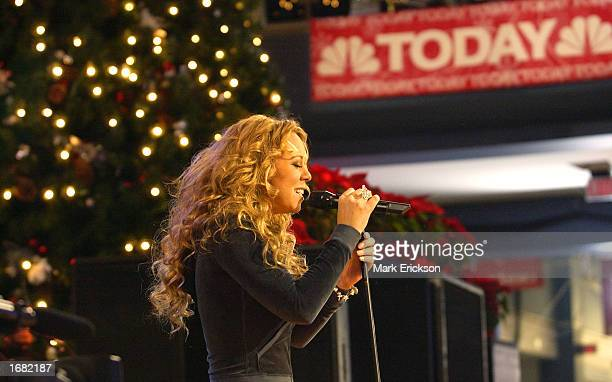 Singer Mariah Carey performs songs from her new album 'Charmbracelet' live on NBC's 'Today' show at the Mall of America December 11 2002 in...