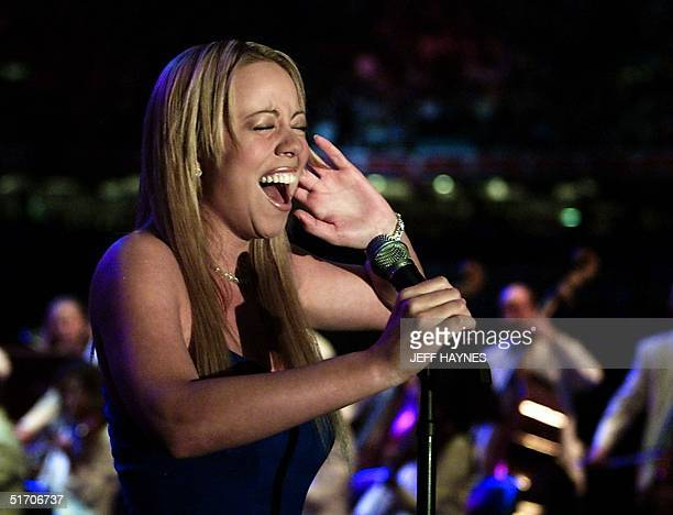 Singer Mariah Carey performs The National Anthem 03 February 2002 at the Louisiana Superdome before Super Bowl XXXVI in New Orleans Louisiana The St...