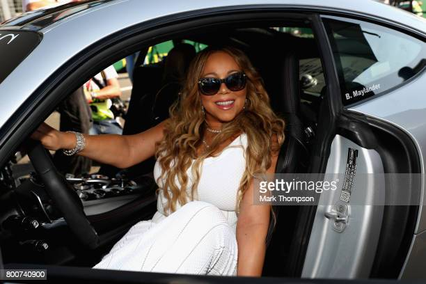 Singer Mariah Carey poses for a photo in the saftey car on the grid before the Azerbaijan Formula One Grand Prix at Baku City Circuit on June 25 2017...