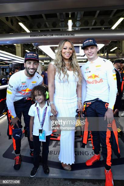 Singer Mariah Carey poses for a photo with Daniel Ricciardo of Australia and Red Bull Racing and Max Verstappen of Netherlands and Red Bull Racing...