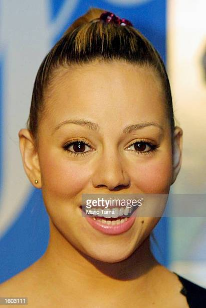 Singer Mariah Carey poses for photographers at The Wall music store where she signed autographs for fans July 20 2001 in Mineola New York