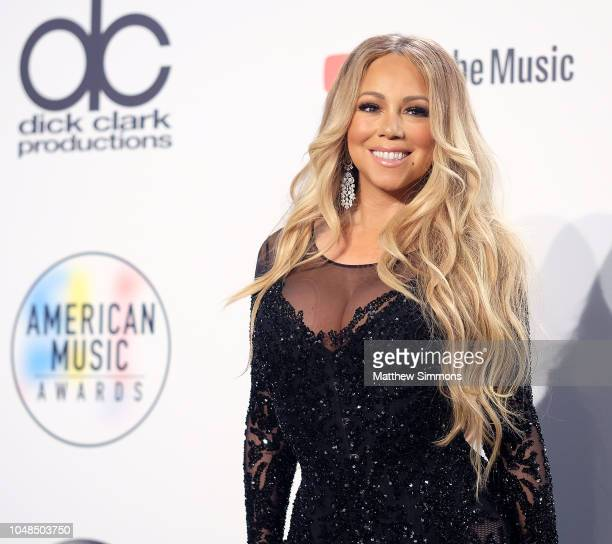 Singer Mariah Carey poses in the press room during the 2018 American Music Awards at Microsoft Theater on October 9 2018 in Los Angeles California