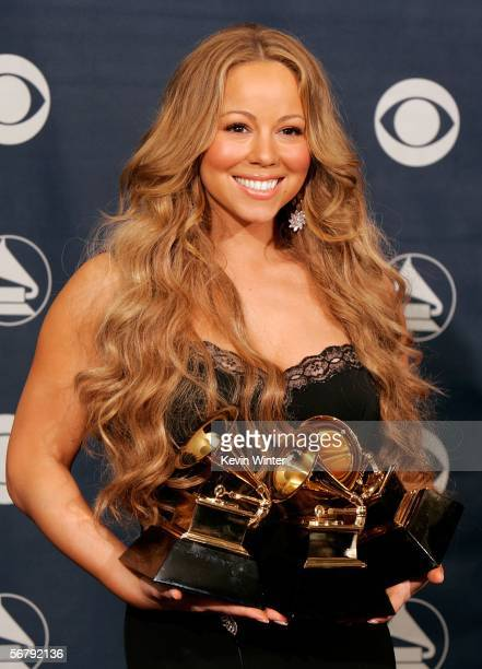 Singer Mariah Carey poses with her Best Female RB Vocal Performance Best Contemporary RB Album and Best RB Song awards in the press room at the 48th...