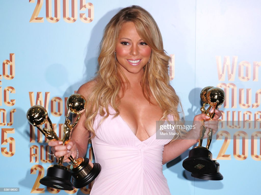 Singer Mariah Carey poses with her trophies in the press room at the 2005 World Music Awards at the Kodak Theatre on August 31, 2005 in Hollywood, California.
