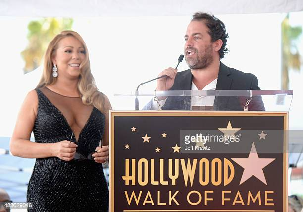 Singer Mariah Carey with director/producer Brett Ratner is honored with Star on The Hollywood Walk of Fame on August 5 2015 in Hollywood California
