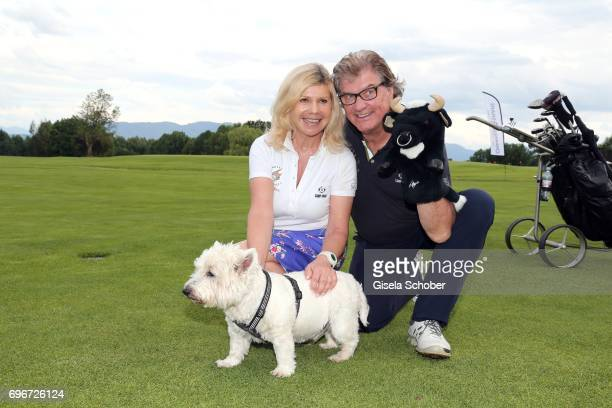 Singer Marianne Hartl and her husband Michael Hartl with their dog Winnie during the 2nd I'm Living Charity Golf Cup at Golfclub Beuerberg on June 16...