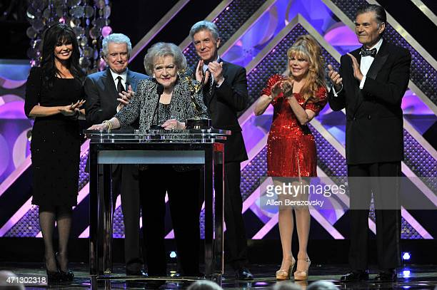 Singer Marie Osmond tv personality Regis Philbin actress Betty White tv personality Tom Bergeron actors Charo and Fred Willard speak onstage during...