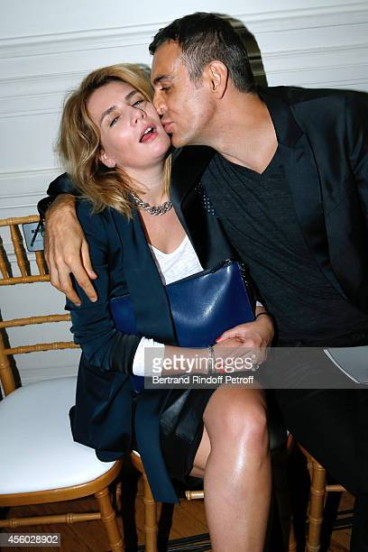 Singer MarieAmelie Seigner and Dragan Nikolic attend the Alexis Mabille show as part of the Paris Fashion Week Womenswear Spring/Summer 2015 on...