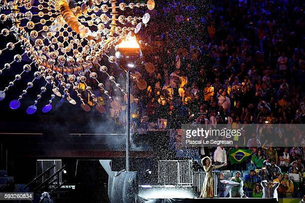 Singer Mariene de Castro performs in front of the Olympic Cauldron before being extinguished during the Closing Ceremony on Day 16 of the Rio 2016...