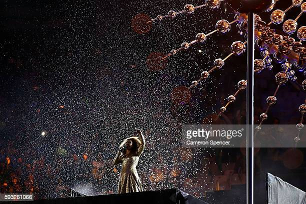 Singer Mariene de Castro performs in front of the Olympic Cauldron during the Closing Ceremony on Day 16 of the Rio 2016 Olympic Games at Maracana...