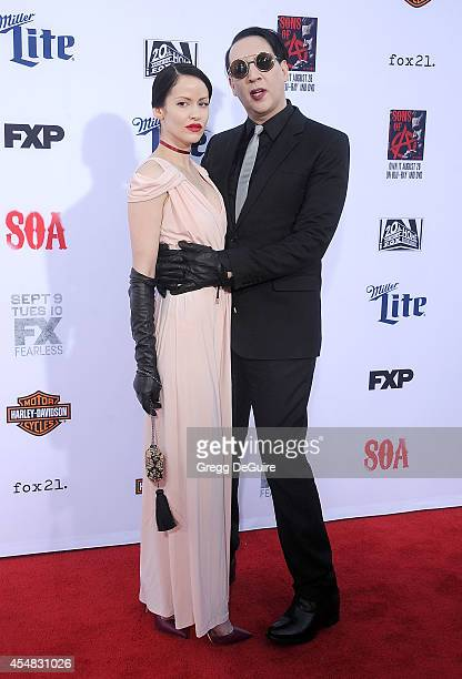 Singer Marilyn Manson and Lindsay Usich arrive at FX's Sons Of Anarchy premiere at TCL Chinese Theatre on September 6 2014 in Hollywood California