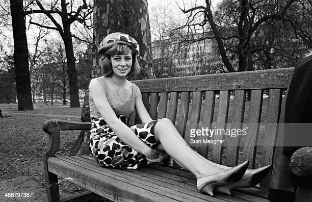 Singer Marilyn Powell modeling clothing in a park February 27th 1964