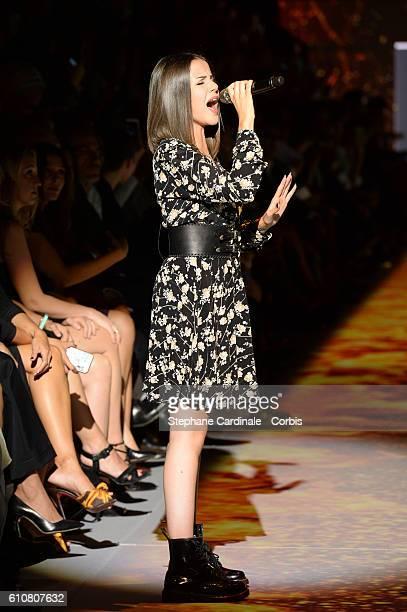 Singer Marina Kaye performs during the Etam show as part of the Paris Fashion Week Womenswear Spring/Summer 2017 on September 27 2016 in Paris France