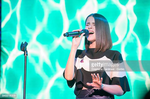 Singer Marina Kaye performs during the Sunny Side of Life By Piaget Launch Partyshow as part of Paris Fashion Week on July 4 2016 in Paris France