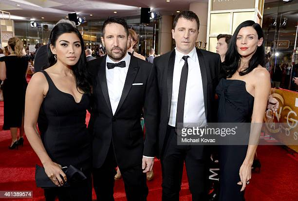 Singer Mariqueen Maandig musician Trent Reznor musician Atticus Ross and model Liberty Ross attend the 72nd Annual Golden Globe Awards at The Beverly...