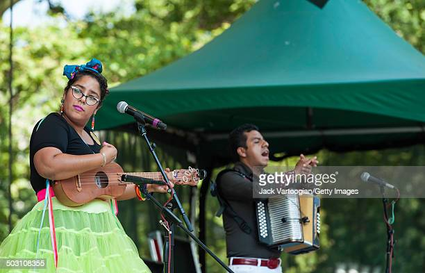 Singer Marisol 'La Marisoul' Hernandez and Jose 'Pepe' Carlos on accordion of the band La Santa Cecilia performs at the final concert of the 15th...