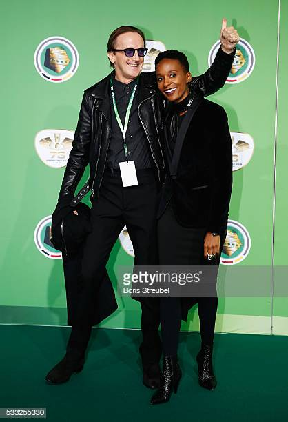 Singer Marius Mueller Westernhagen and Lindiwe Andrea Suttle pose for a picture at the green carpet prior to the DFB Cup Final between Bayern...