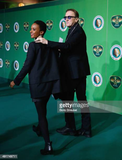 Singer Marius MuellerWesternhagen and his girlfriend Lindiwe Suttle walk on the green carpet prior to the DFB Cup final at Olympiastadion on May 17...