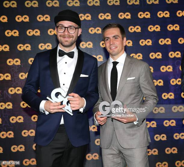 Singer Mark Forster and Philipp Lahm Soccerplayer FC Bayern Muenchen with award during the show of the GQ Men of the year Award 2017 at Komische Oper...