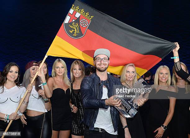 Singer Mark Forster celebrates after winning the Bundesvision Song Contest 2015 at OVBArena on August 29 2015 in Bremen Germany