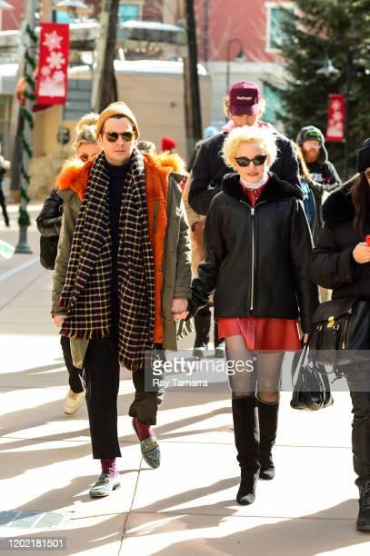 Singer Mark Foster and actress Julia Garner walks on Main Street on January 26 2020 in Park City Utah