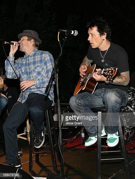 Singer Mark Mcgrath and musician Billy Morrison perform at a Wonderland Avenue School fund raising event at a private residence on October 10, 2009...