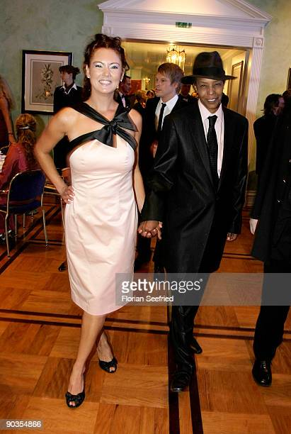 Singer Marla Glen and his wife Sabrina Conley attend the 'UNICEFGala' at Park Hotel on September 5 2009 in Bremen Germany