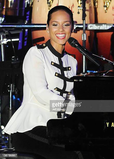 Singer Marsha Ambrosius performs onstage at Clive Davis and the Recording Academy's 2012 Pre-GRAMMY Gala and Salute to Industry Icons Honoring...