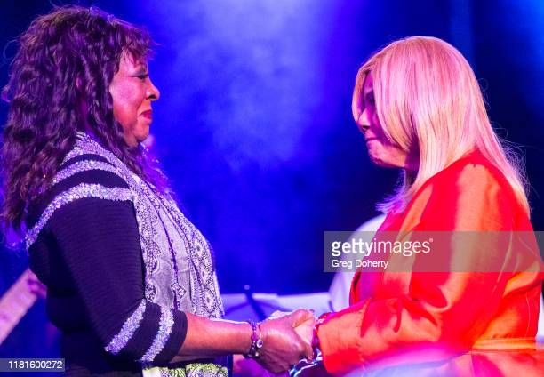 Singer Martha Reeves recipient of the Casino Entertainment Legend Award is greeted by singer/songwriter Claudette Rogers Robinson at at the Global...