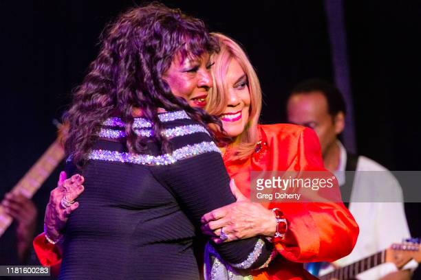 Singer Martha Reeves recipient of the Casino Entertainment Legend Award is greeted by singer/songwriter Claudette Rogers Robinson at the Global...