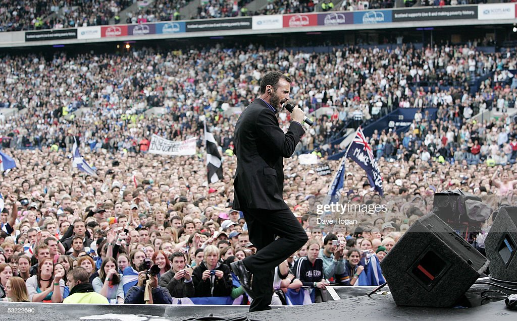 Singer Marti Pellow of Wet Wet Wet performs on stage at the Live 8 Edinburgh concert at Murrayfield Stadium on July 6, 2005 in Edinburgh, Scotland. The free gig, labelled Edinburgh 50,000 - The Final Push, is organised by Midge Ure, alongside Geldof, and coincides with the G8 summit to raise awareness for MAKEpovertyHISTORY.