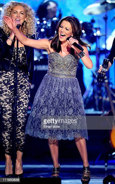 Singer Martina McBride and musician Kimberly Schlapman of Little Big Town perform onstage during ACM Presents Girls' Night Out Superstar Women of...