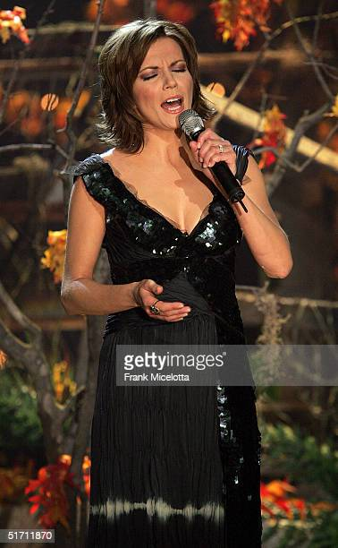 Singer Martina McBride performs on stage at the 38th Annual CMA Awards at the Grand Ole Opry House November 9 2004 in Nashville Tennessee