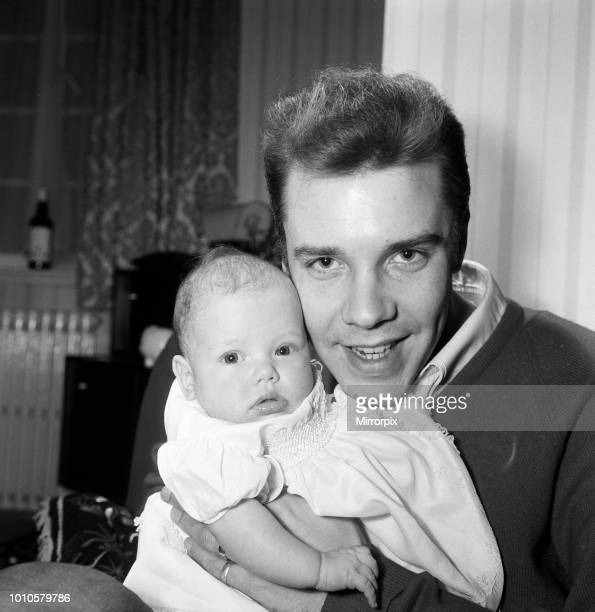 Singer Marty Wilde at home in Chiswick with his baby daughter Kim 30th January 1961