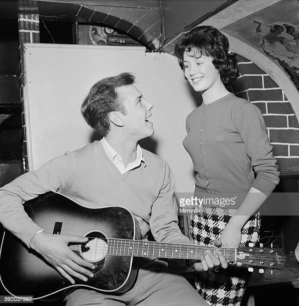 Singer Marty Wilde sings to his fiancee Joyce Baker 28th October 1959