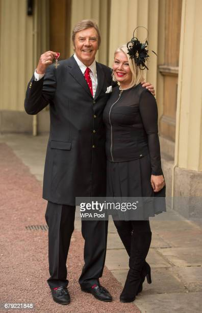 Singer Marty Wilde with his daughter Kim poses with his MBE medal from Queen Elizabeth II at an Investiture ceremony at Buckingham Palace on May 5...