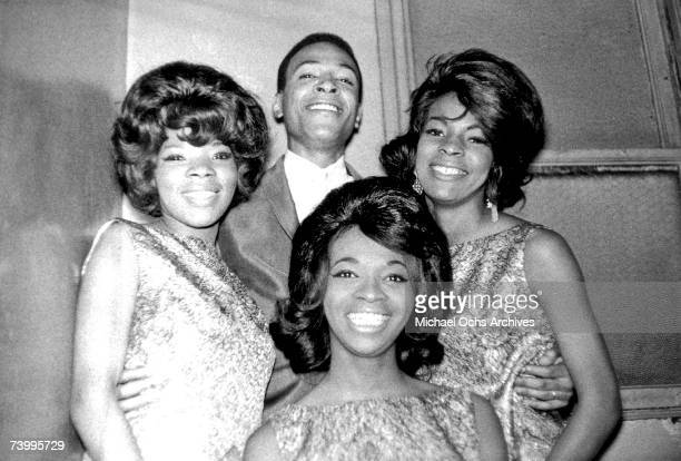 B singer Marvin Gaye poses for a portrait backstage at the Apollo Theater with female RB vocal group 'Martha The Vandellas' in 1962 in New York City...