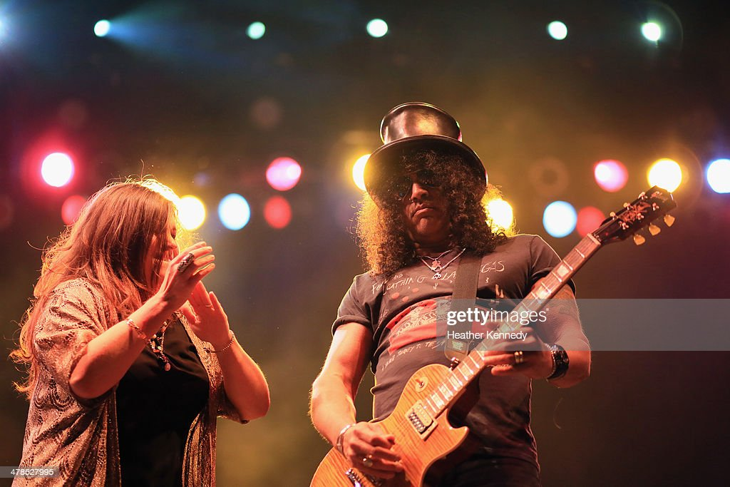 Singer Mary Bridget Davies and musician Slash perform onstage during the USPS Hendrix Stamp Event + Los Lonely Boys during the 2014 SXSW Music, Film + Interactive at Butler Park on March 13, 2014 in Austin, Texas.