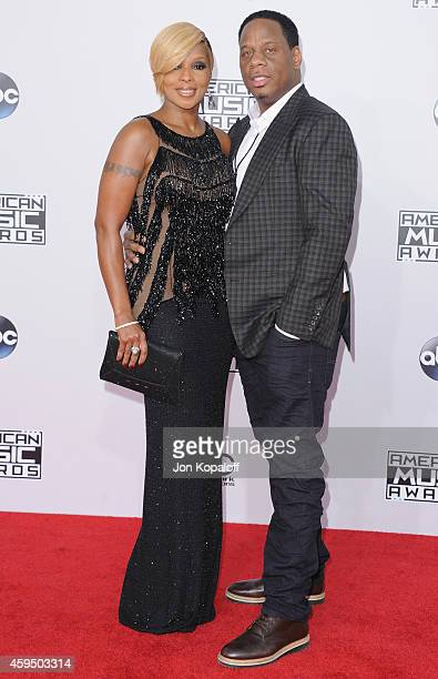 Singer Mary J Blige and husband Kendu Isaacs arrive at the 2014 American Music Awards at Nokia Theatre LA Live on November 23 2014 in Los Angeles...