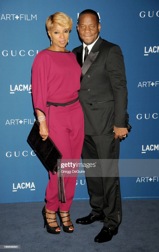 Singer Mary J. Blige and husband Kendu Isaacs arrive at the LACMA 2013 Art + Film Gala at LACMA on November 2, 2013 in Los Angeles, California.