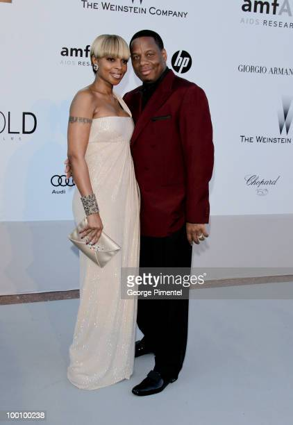 Singer Mary J Blige and Kendu Isaacs attend amfAR's Cinema Against AIDS Gala at the Hotel Du Cap during the 63rd International Cannes Film Festival...