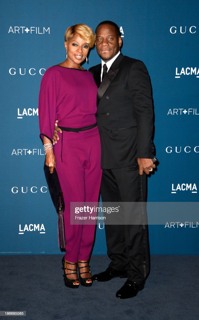 Singer Mary J. Blige and record producer Kendu Isaacs arrive at the LACMA 2013 Art + Film Gala on November 2, 2013 in Los Angeles, California.