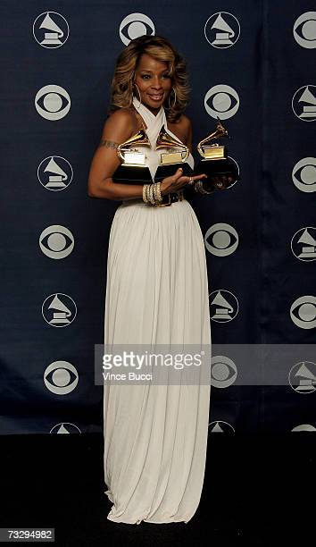 Singer Mary J Blige poses with her Grammys for Best RB Song for 'Be Without You' Best RB Album for 'The Breakthrough' and Best Female RB Vocal...