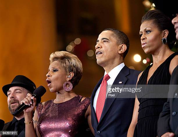 Singer Mary J Blige sings as Kristian Bush US President Barack Obama and First Lady Michelle Obama look on during the Christmas in Washington...