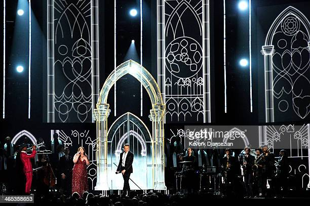 Singer Mary Lambert, rapper Macklemore, singer/actress Queen Latifah, and musician Ryan Lewis perform onstage during the 56th GRAMMY Awards at...
